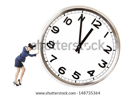 Business woman is pushing a big clock. - stock photo