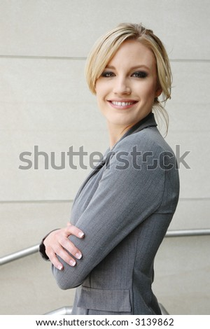 business woman is thinking about the future with a smile - stock photo