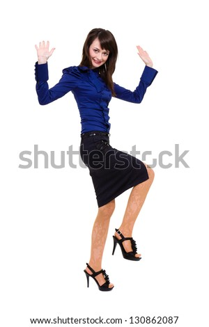 Business woman jumping with happiness. Isolated on white background in full length.