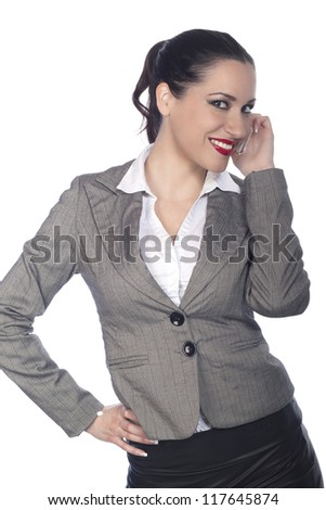 business woman laughing and talking with mobile phone - stock photo