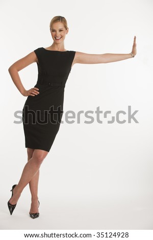 business woman leaning on copy space on white seamless background