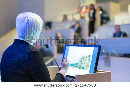 Business woman lecturing at Conference. Audience at the lecture hall. - stock photo