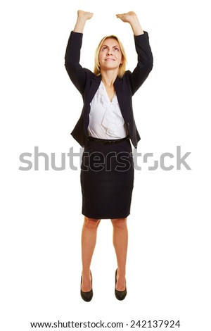 Business woman lifting imaginary object up over her head - stock photo