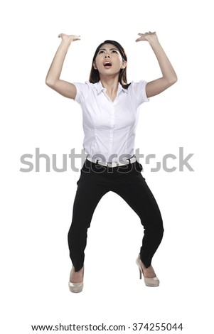 Business woman lifting something heavy isolated over white - stock photo