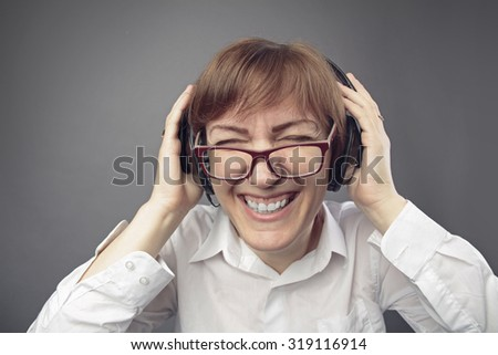 business woman listening to music