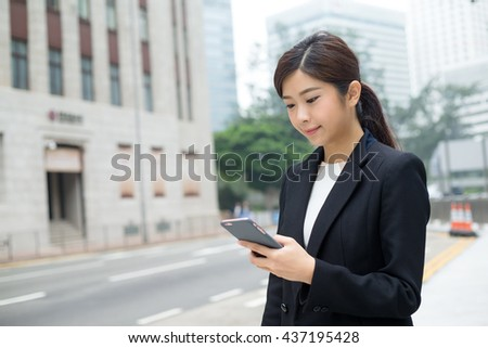 Business woman look at the phone