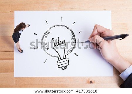 business woman look paper and see idea and light bulb on the paper, asian - stock photo