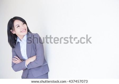 business woman look something with white wall background, great for your design or text, asian