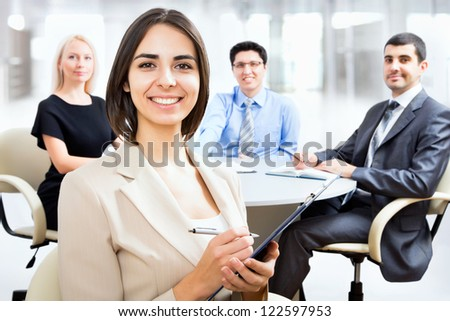 Business woman looking at camera with a smile
