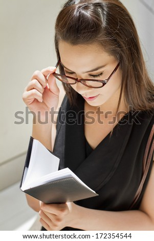 business woman looking at her notebook planner