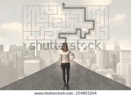 Business woman looking at road with maze and solution concept - stock photo
