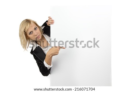 Business woman looking out of white billboard