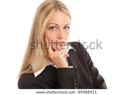Business woman looking seriously into camera