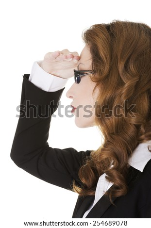Business woman looking somewhere far away with hand above eyes.  - stock photo