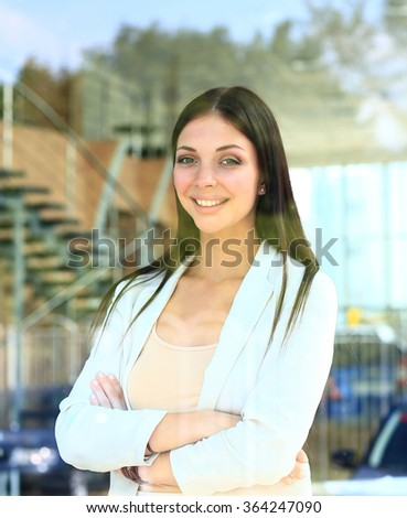 business woman looking thtough window in the office - stock photo