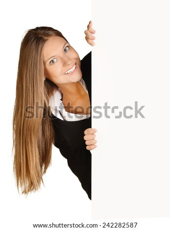 Business woman looks out from behind a blank white sheet of paper