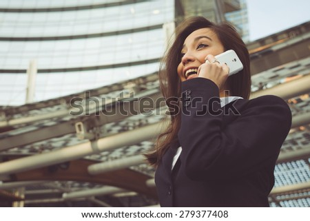 business woman making a phone call outside the office. concept about business people and professions - stock photo
