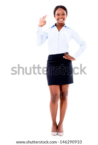 Business woman making an ok sing - isolated over a white background - stock photo