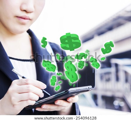 Business woman making money online by using mobile phone  - stock photo