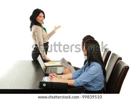 Business woman making presentation to blank wall at meeting isolated on white background - stock photo