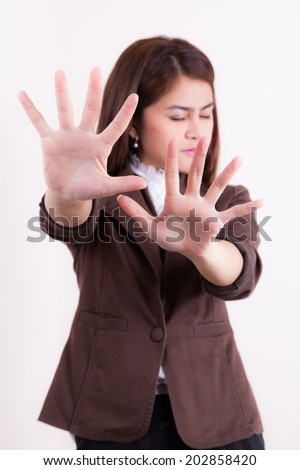 business woman making stop hand sign isolated - stock photo