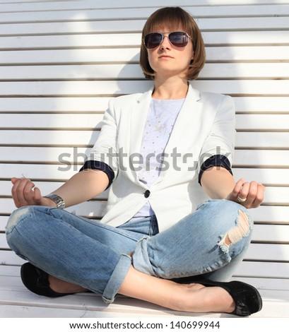 Business woman meditating and making yoga - stock photo