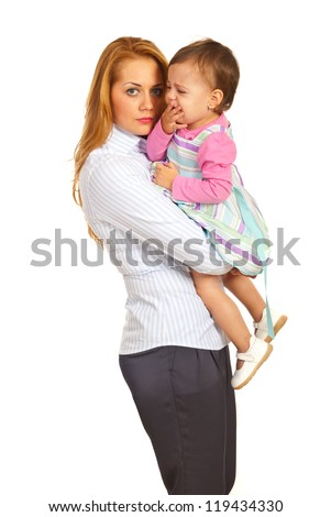 Business woman mother holding crying toddler girl isolated on white background - stock photo