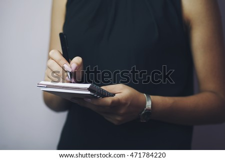 Business woman note something in diary