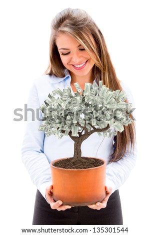Business woman nurturing a money tree - isolated over white background - stock photo