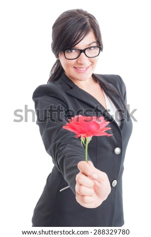 Business woman offering a flower to the camera on white background - stock photo