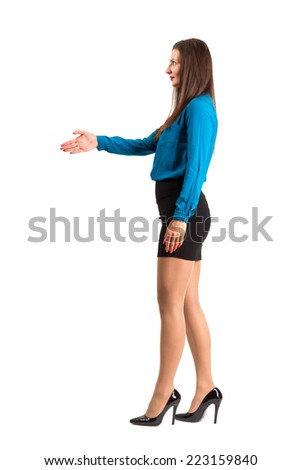 Business woman offering hand for handshake. Full body length isolated over white background. - stock photo