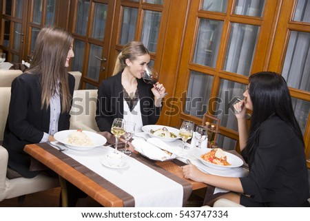 Business woman on a lunch break. Beautiful young woman eating at the restaurant.