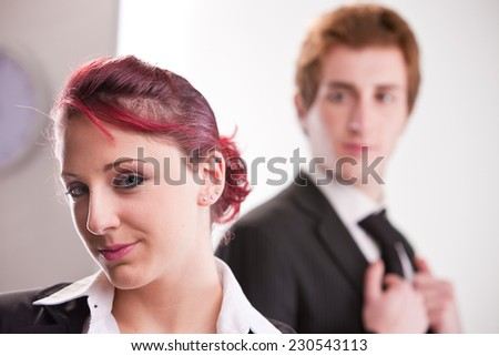 business woman on foreground and man on background