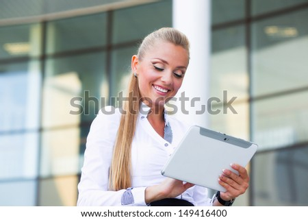 Business woman on the street  with tablet
