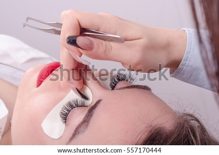 Business woman or girl enjoys salon and upgraded eyelashes, she relaxes with a face close up