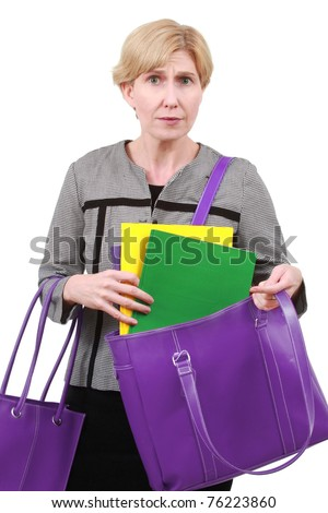 Business woman overburdened with files - stock photo
