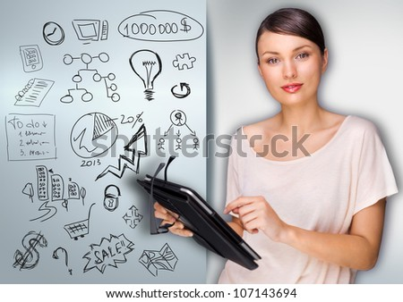 Business woman planning using her tablet computer - stock photo