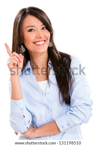 Business woman pointing an idea and smiling - isolated over white - stock photo