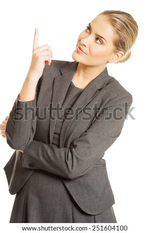 Business woman pointing at copyspace. - stock photo
