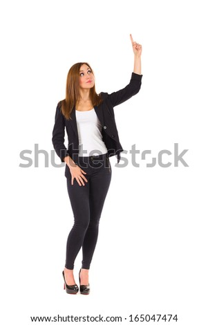 Business woman pointing at empty space. Full length studio shot isolated on white.