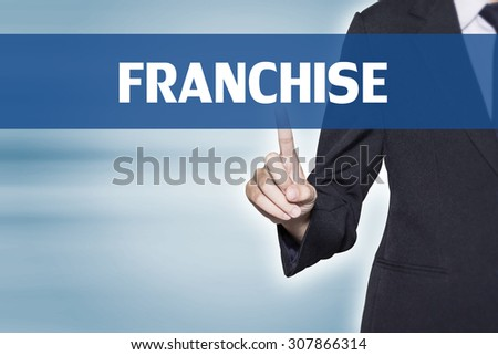 Business woman pointing at FRANCHISE word for business background concept - stock photo