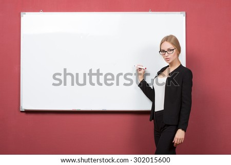 business woman pointing at the whiteboard - stock photo