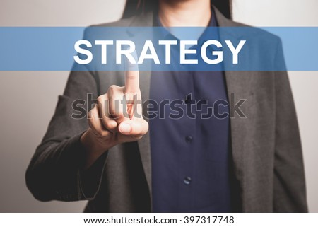 Business woman pointing at word of Strategy - stock photo