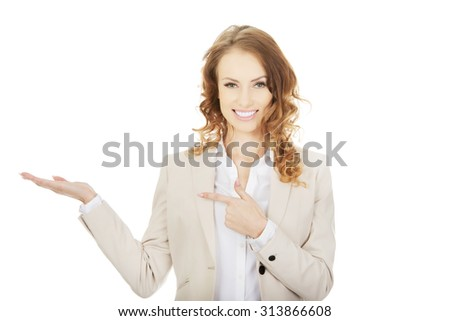 Business woman pointing on her hand. - stock photo