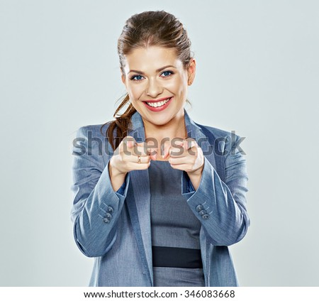 business woman points of finger forward. question in a gesture. studio isolated - stock photo