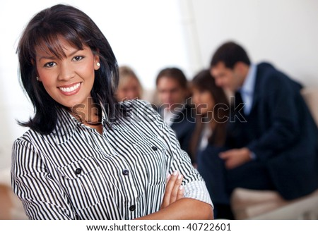 Business woman portrait at an office smiling
