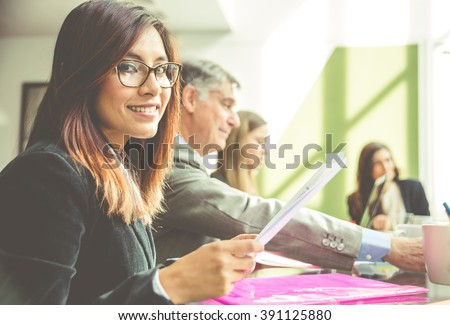 Business woman portrait in an office. woman in an office smiling at camera - stock photo