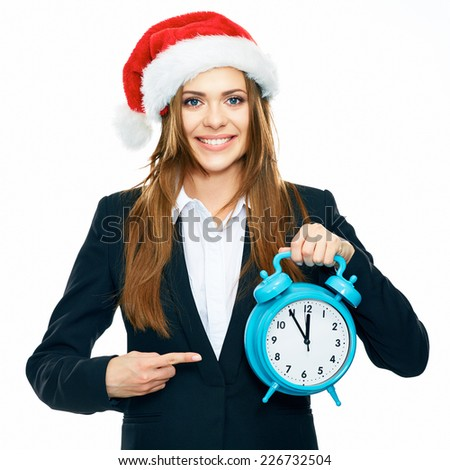 Business woman portrait in Christmas style . Woman pointing finger at the watch. New Year time. - stock photo