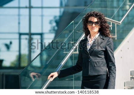 Business woman portrait outdoors with modern building as background.
