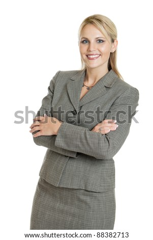 Business woman portrait with arms folded isolated on a white background - stock photo